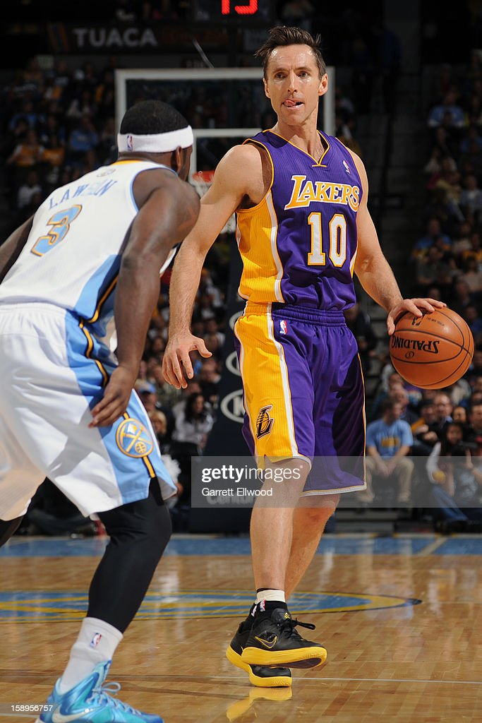 <a gi-track='captionPersonalityLinkClicked' href=/galleries/search?phrase=Steve+Nash+-+Basketspelare&family=editorial&specificpeople=201513 ng-click='$event.stopPropagation()'>Steve Nash</a> #10 of the Los Angeles Lakers looks to pass the ball against the Denver Nuggets on December 26, 2012 at the Pepsi Center in Denver, Colorado.