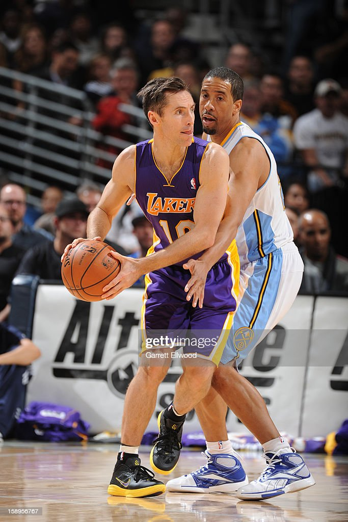 <a gi-track='captionPersonalityLinkClicked' href=/galleries/search?phrase=Steve+Nash+-+Basketball+Player&family=editorial&specificpeople=201513 ng-click='$event.stopPropagation()'>Steve Nash</a> #10 of the Los Angeles Lakers looks to pass the ball against the Denver Nuggets on December 26, 2012 at the Pepsi Center in Denver, Colorado.