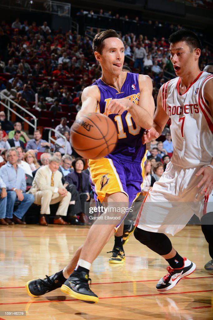 Steve Nash #10 of the Los Angeles Lakers passes the ball against Jeremy Lin #7 of the Houston Rockets on January 8, 2013 at the Toyota Center in Houston, Texas.