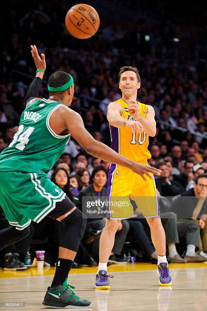 Steve Nash #10 of the Los Angeles Lakers passes the ball against Paul Pierce #34 of the Boston Celtics at Staples Center on February 20, 2013 in Los Angeles, California.