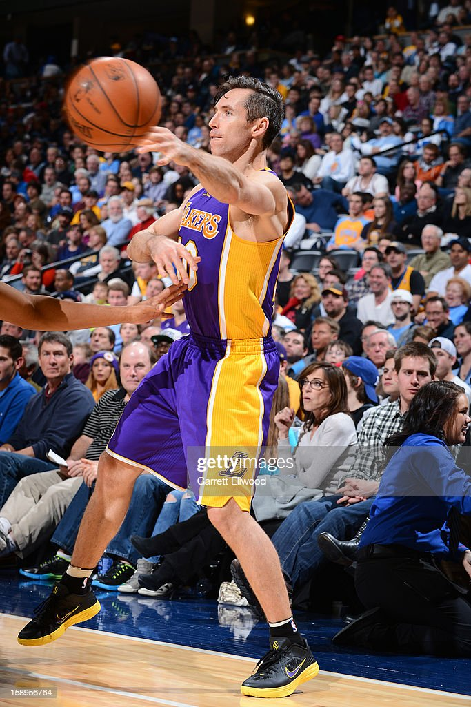 <a gi-track='captionPersonalityLinkClicked' href=/galleries/search?phrase=Steve+Nash+-+Basketball+Player&family=editorial&specificpeople=201513 ng-click='$event.stopPropagation()'>Steve Nash</a> #10 of the Los Angeles Lakers passes the ball against the Denver Nuggets on December 26, 2012 at the Pepsi Center in Denver, Colorado.