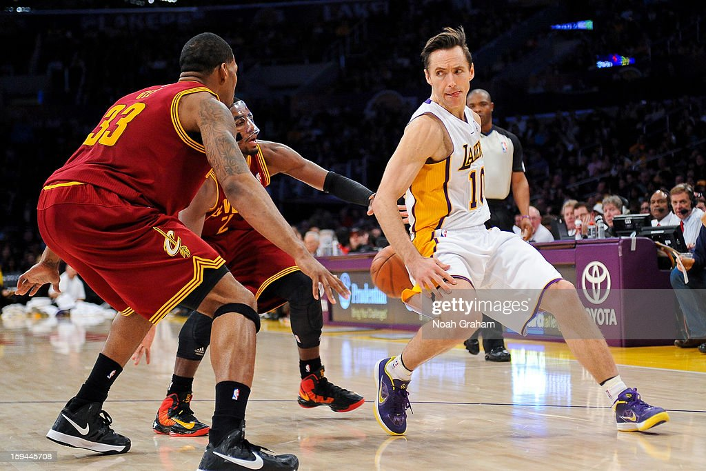 <a gi-track='captionPersonalityLinkClicked' href=/galleries/search?phrase=Steve+Nash&family=editorial&specificpeople=201513 ng-click='$event.stopPropagation()'>Steve Nash</a> #10 of the Los Angeles Lakers passes the ball behind his back against <a gi-track='captionPersonalityLinkClicked' href=/galleries/search?phrase=Alonzo+Gee&family=editorial&specificpeople=801443 ng-click='$event.stopPropagation()'>Alonzo Gee</a> #33 and <a gi-track='captionPersonalityLinkClicked' href=/galleries/search?phrase=Kyrie+Irving&family=editorial&specificpeople=6893971 ng-click='$event.stopPropagation()'>Kyrie Irving</a> #2 of the Cleveland Cavaliers at Staples Center on January 13, 2013 in Los Angeles, California.