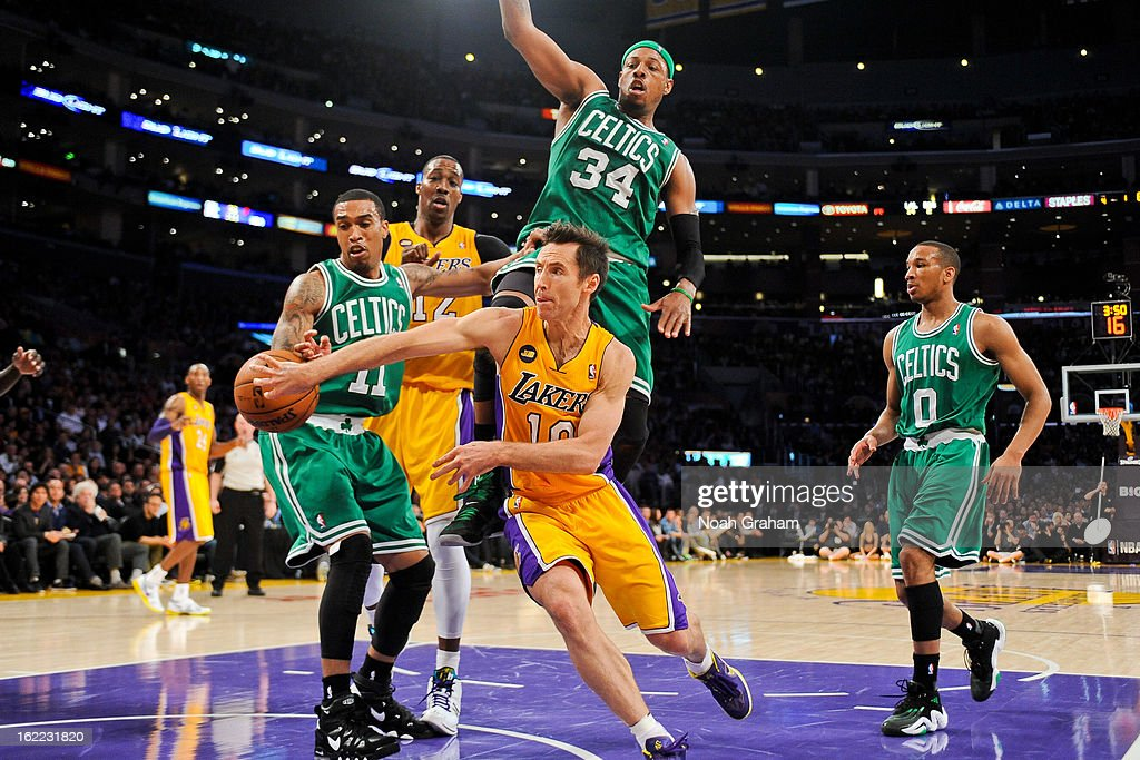 Steve Nash #10 of the Los Angeles Lakers passes the ball in the lane against Courtney Lee #11 and Paul Pierce #34 of the Boston Celtics at Staples Center on February 20, 2013 in Los Angeles, California.