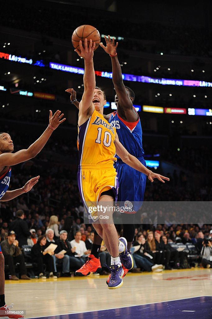 Steve Nash #10 of the Los Angeles Lakers rises for a layup against the Philadelphia 76ers at Staples Center on January 1, 2013 in Los Angeles, California.