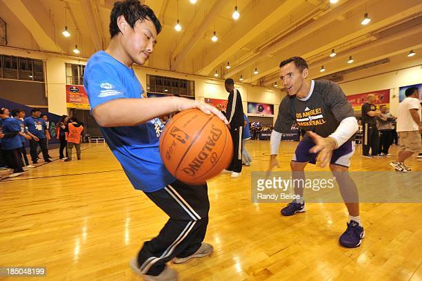 Steve Nash of the Los Angeles Lakers runs drills with the participants during the NBA Cares Special Olympics Clinic as part of the 2013 Global Games...