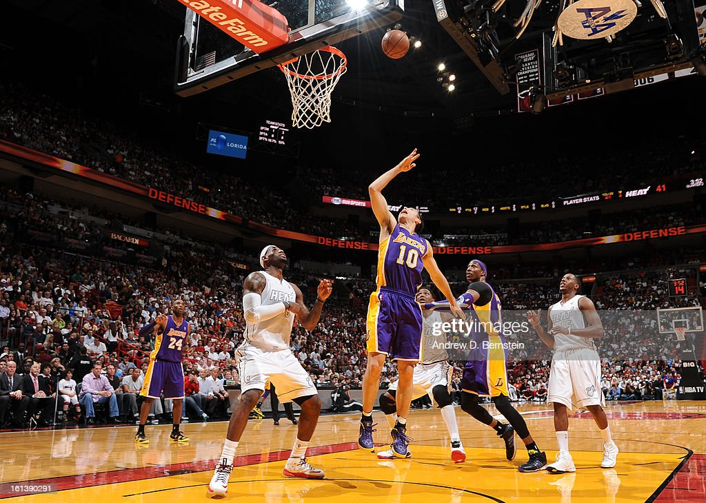 Steve Nash #10 of the Los Angeles Lakers sends the ball to the basket during a game between the Los Angeles Lakers and the Miami Heat on February 10, 2013 at American Airlines Arena in Miami, Florida.