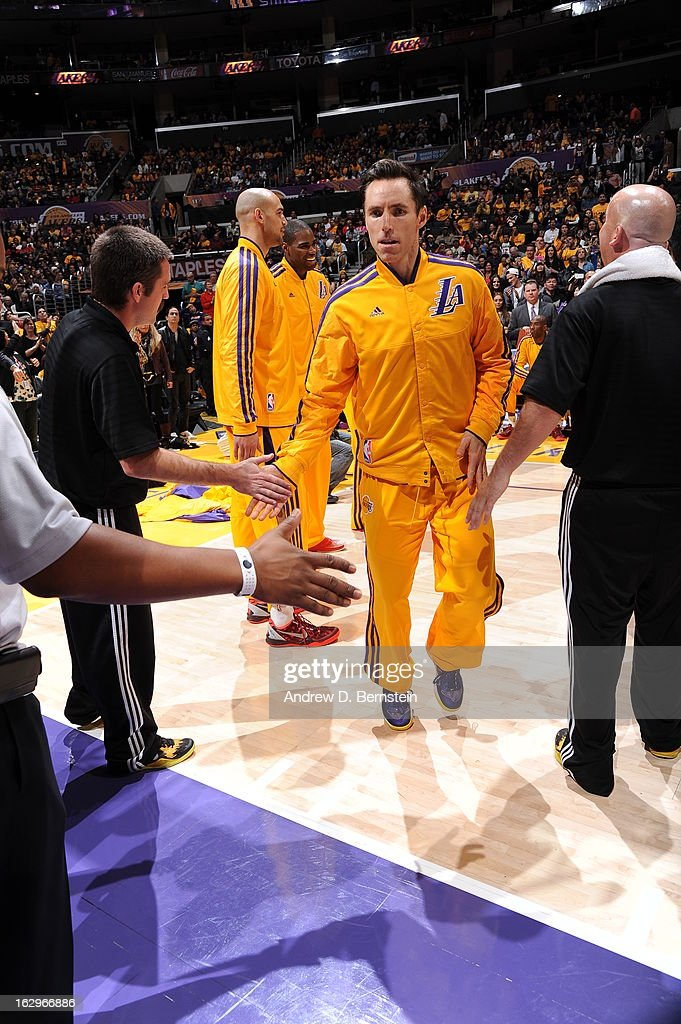 <a gi-track='captionPersonalityLinkClicked' href=/galleries/search?phrase=Steve+Nash&family=editorial&specificpeople=201513 ng-click='$event.stopPropagation()'>Steve Nash</a> #10 of the Los Angeles Lakers shakes hands with people after the game against the Los Angeles Clippers at Staples Center on February 14, 2013 in Los Angeles, California.