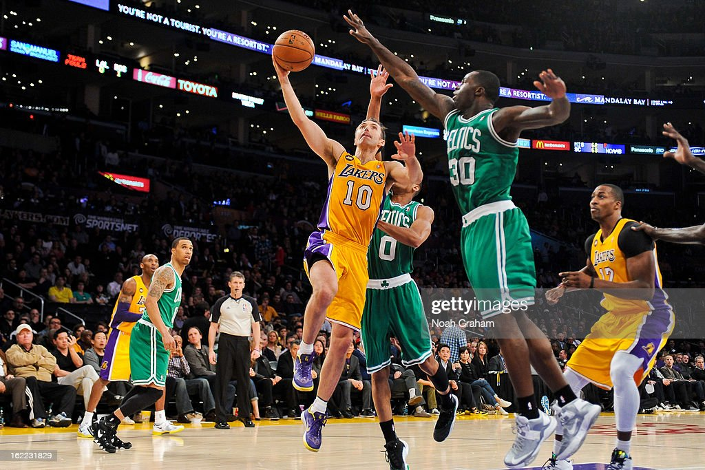 <a gi-track='captionPersonalityLinkClicked' href=/galleries/search?phrase=Steve+Nash&family=editorial&specificpeople=201513 ng-click='$event.stopPropagation()'>Steve Nash</a> #10 of the Los Angeles Lakers shoots a layup against <a gi-track='captionPersonalityLinkClicked' href=/galleries/search?phrase=Brandon+Bass&family=editorial&specificpeople=233806 ng-click='$event.stopPropagation()'>Brandon Bass</a> #30 and <a gi-track='captionPersonalityLinkClicked' href=/galleries/search?phrase=Avery+Bradley&family=editorial&specificpeople=5792051 ng-click='$event.stopPropagation()'>Avery Bradley</a> #0 of the Boston Celtics at Staples Center on February 20, 2013 in Los Angeles, California.