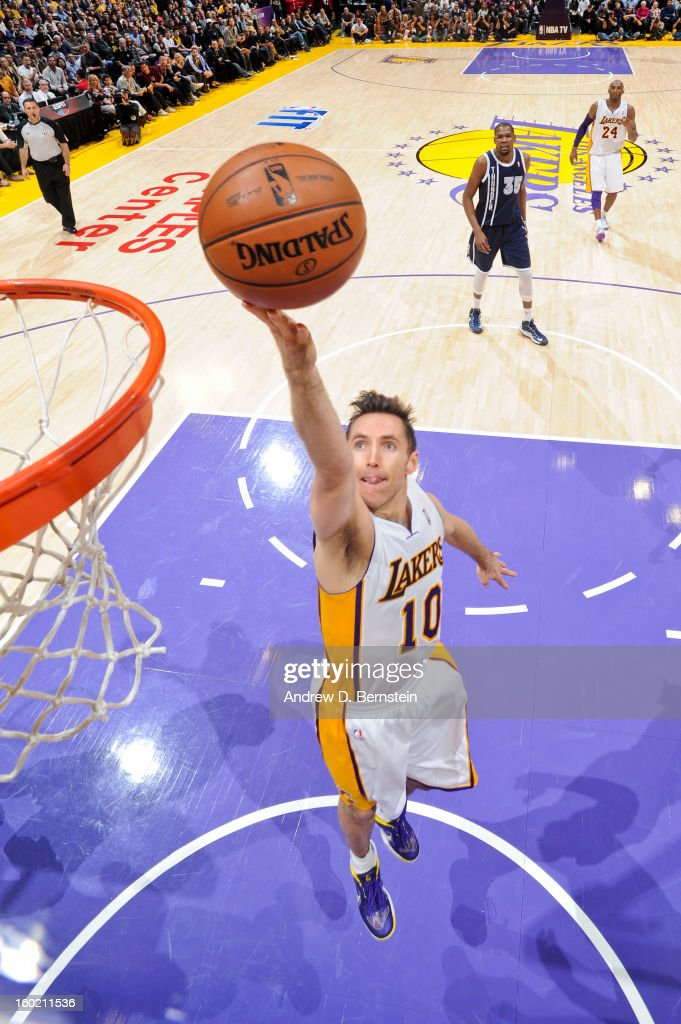 Steve Nash #10 of the Los Angeles Lakers shoots a layup against the Oklahoma City Thunder at Staples Center on January 27, 2013 in Los Angeles, California.