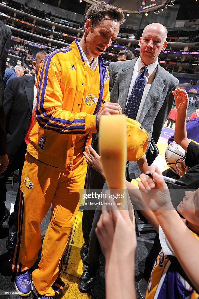 Steve Nash #10 of the Los Angeles Lakers signs autographs after his team's victory against the Boston Celtics at Staples Center on February 20, 2013 in Los Angeles, California.