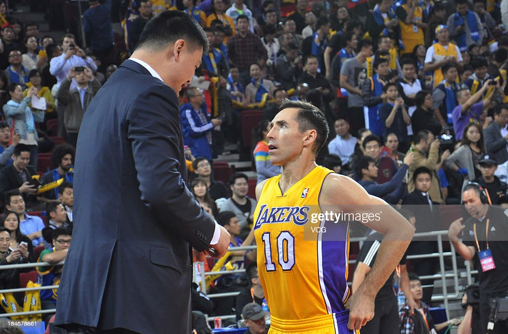 <a gi-track='captionPersonalityLinkClicked' href=/galleries/search?phrase=Steve+Nash+-+Basketball+Player&family=editorial&specificpeople=201513 ng-click='$event.stopPropagation()'>Steve Nash</a> #10 of the Los Angeles Lakers talks with <a gi-track='captionPersonalityLinkClicked' href=/galleries/search?phrase=Yao+Ming&family=editorial&specificpeople=201476 ng-click='$event.stopPropagation()'>Yao Ming</a> during the 2013 Global Games at the MasterCard Center on October 15, 2013 in Beijing, China.