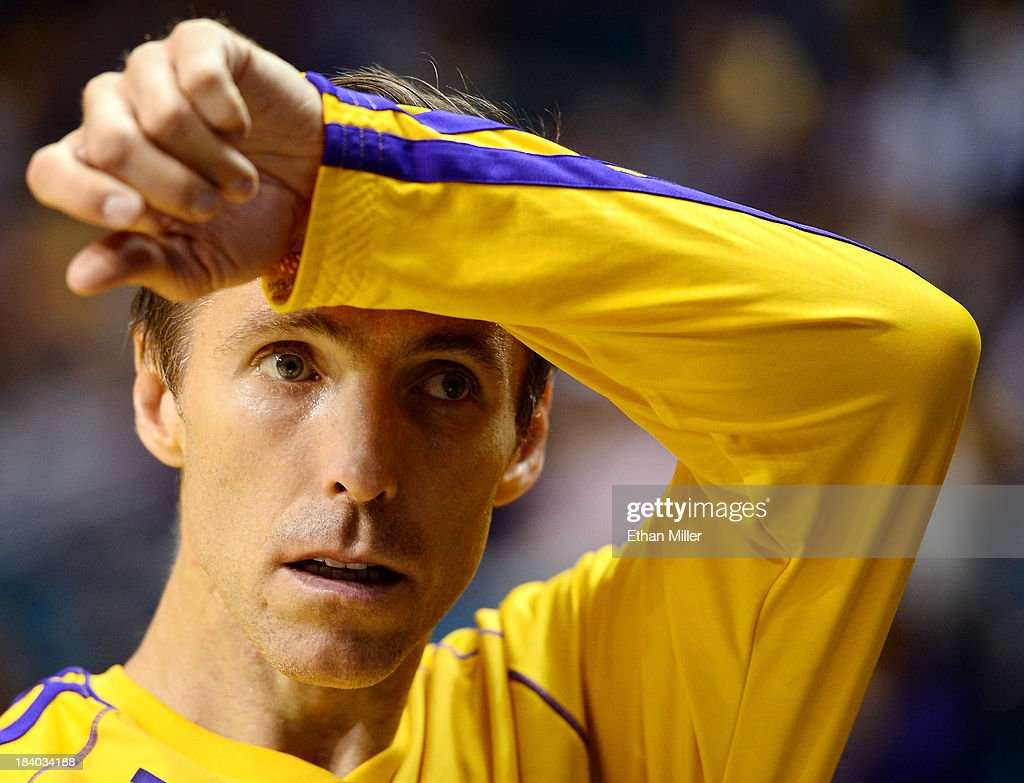 Steve Nash #10 of the Los Angeles Lakers wipes his brow during warmups before a preseason game against the Sacramento Kings at the MGM Grand Garden Arena on October 10, 2013 in Las Vegas, Nevada. Sacramento won 104-86.