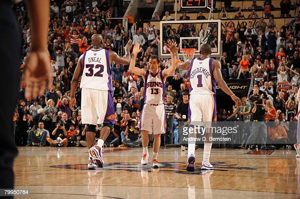 Steve Nash of the Phoenix Suns celebrates a basket with Shaquille O'Neal and Amare Stoudemire in an NBA game played against the Boston Celtics at US...