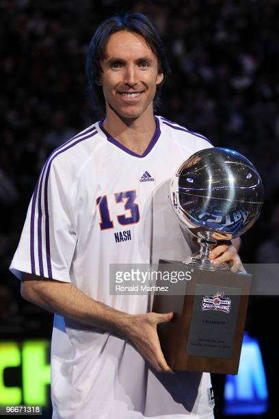 Steve Nash of the Phoenix Suns celebrates with the Champions Trophy after winning the Taco Bell Skills Challenge on AllStar Saturday Night part of...