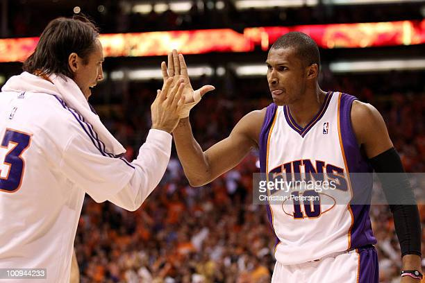 Steve Nash of the Phoenix Suns congratulates teammate Leandro Barbosa after a play against the Los Angeles Lakers in the fourth quarter of Game Four...