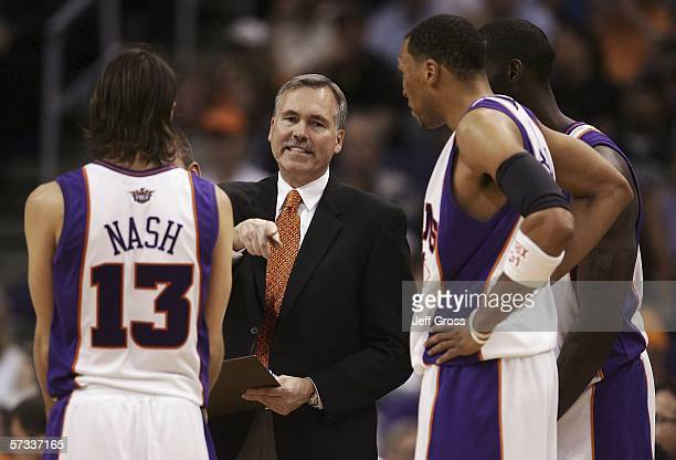 Steve Nash of the Phoenix Suns discusses a play with head coach Mike D'Antoni Shawn Marion and Tim Thomas during a time out in the second half of the...