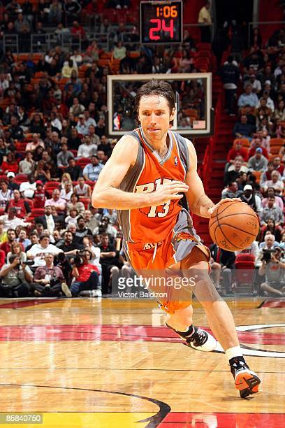 Steve Nash of the Phoenix Suns dribbles against the Miami Heat during the game at American Airlines Arena on March 4 2009 in Miami Florida The Heat...