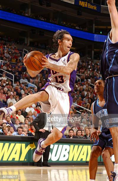 Steve Nash of the Phoenix Suns drives against the Utah Jazz on February 14 2005 at America West Arena in Phoenix Arizona The Suns defeated the Jazz...