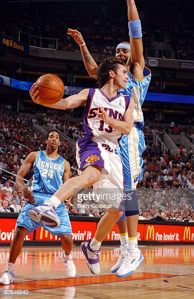 Steve Nash of the Phoenix Suns drives and passes against Kenyon Martin of the Denver Nuggets on April 18 2005 at America West Arena in Phoenix...