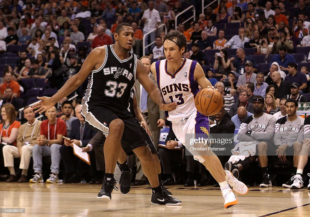 Steve Nash #13 of the Phoenix Suns drives the ball past Boris Diaw #33 of the San Antonio Spurs during the NBA game at US Airways Center on April 25, 2012 in Phoenix, Arizona. The Spurs defeated the Suns 110-106.