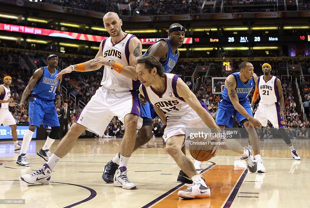 Steve Nash #13 of the Phoenix Suns drives the ball past Marcin Gortat #4 and Brendan Haywood #33 of the Dallas Mavericks during the NBA game at US Airways Center on February 17, 2011 in Phoenix, Arizona.