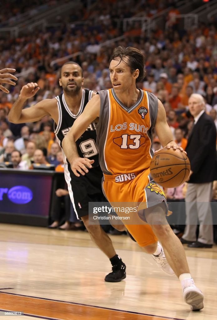 Steve Nash #13 of the Phoenix Suns drives the ball past Tony Parker #9 of the San Antonio Spurs during Game Two of the Western Conference Semifinals of the 2010 NBA Playoffs at US Airways Center on May 5, 2010 in Phoenix, Arizona. The team is wearing 'Los Suns' jerseys on Cinco de Mayo in response to an anti-immigration law recently passed in Arizona. The Suns defeated the Spurs 110-102 to take a 2-0 series lead.