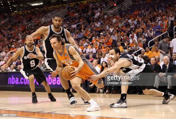 Steve Nash of the Phoenix Suns drives the ball past Tony Parker Tim Duncan and Manu Ginobili of the San Antonio Spurs during Game Two of the Western...