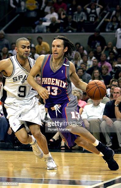 Steve Nash of the Phoenix Suns drives the baseline past Tony Parker of the San Antonio Spurs in Game four of the Western Conference Finals during the...