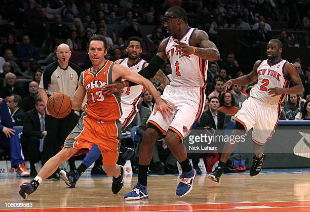 Steve Nash of the Phoenix Suns drives to the basket against Amar'e Stoudemire of the New York Knicks at Madison Square Garden on January 17 2011 in...