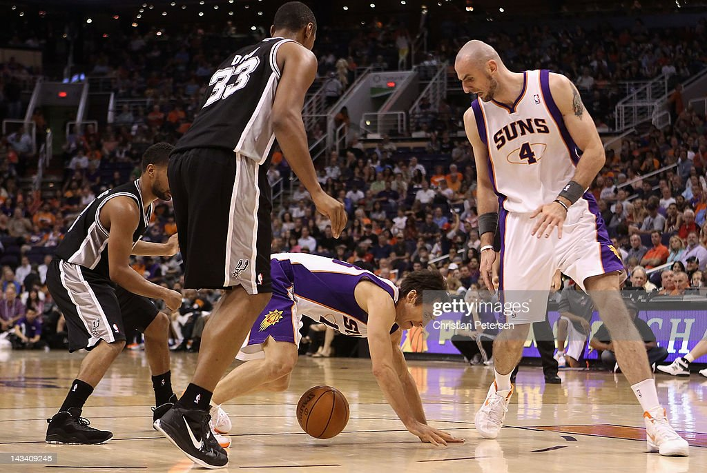 Steve Nash #13 of the Phoenix Suns falls over the ball during the NBA game against the San Antonio Spurs at US Airways Center on April 25, 2012 in Phoenix, Arizona. The Spurs defeated the Suns 110-106.