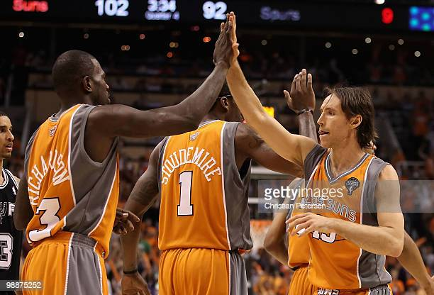 Steve Nash of the Phoenix Suns highfives teammate Jason Richardson after scoring against the San Antonio Spurs during Game Two of the Western...