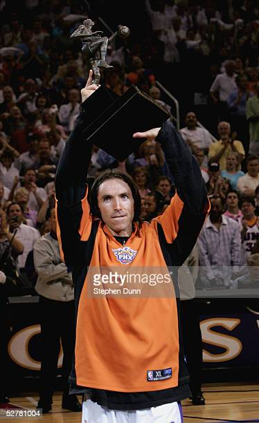 Steve Nash of the Phoenix Suns holds up the NBA Most Valuable Player Trophy before playing the Dallas Mavericks in game one of the Western Conference...