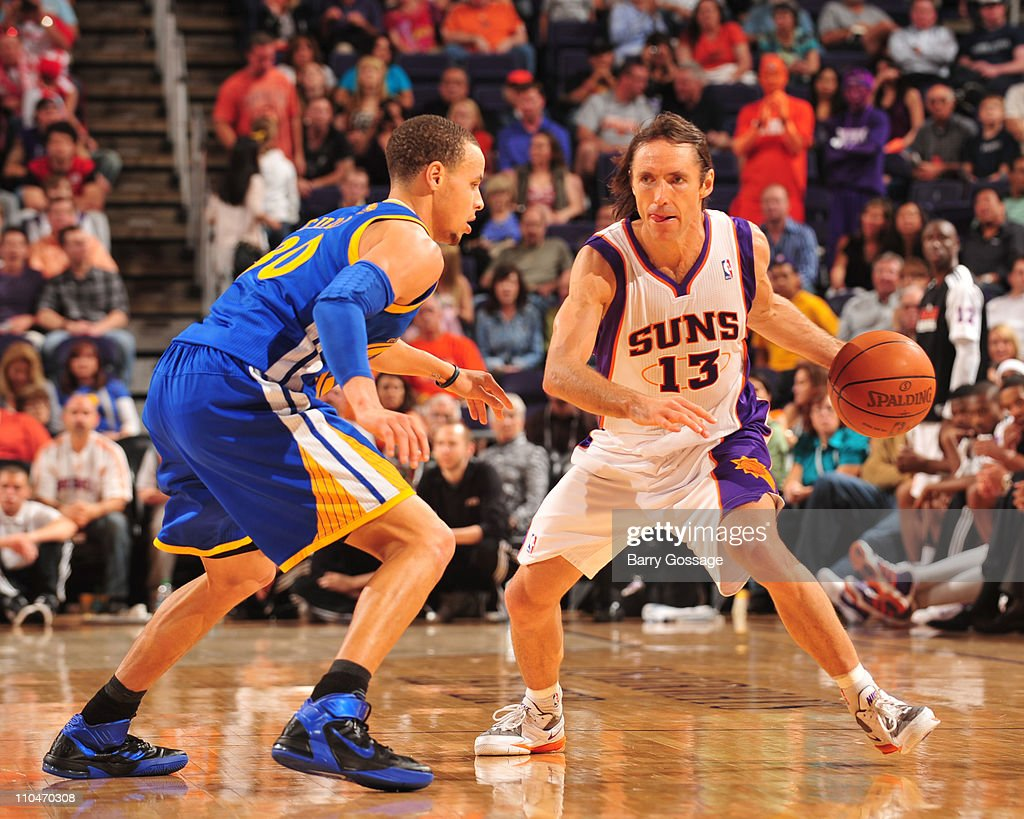 <a gi-track='captionPersonalityLinkClicked' href=/galleries/search?phrase=Steve+Nash&family=editorial&specificpeople=201513 ng-click='$event.stopPropagation()'>Steve Nash</a> #13 of the Phoenix Suns is guarded by Stephen Curry #30 of the Golden State Warriors in an NBA game played on March 18, 2011 at U.S. Airways Center in Phoenix, Arizona.