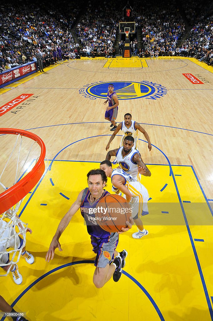 <a gi-track='captionPersonalityLinkClicked' href=/galleries/search?phrase=Steve+Nash&family=editorial&specificpeople=201513 ng-click='$event.stopPropagation()'>Steve Nash</a> #13 of the Phoenix Suns lays the ball up against the Golden State Warriors defense on February 7, 2011 at Oracle Arena in Oakland, California.