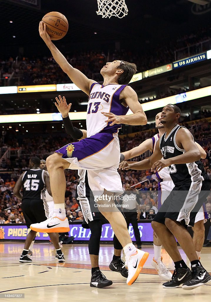 <a gi-track='captionPersonalityLinkClicked' href=/galleries/search?phrase=Steve+Nash&family=editorial&specificpeople=201513 ng-click='$event.stopPropagation()'>Steve Nash</a> #13 of the Phoenix Suns lays up a shot against the San Antonio Spurs during the NBA game at US Airways Center on April 25, 2012 in Phoenix, Arizona. The Spurs defeated the Suns 110-106.