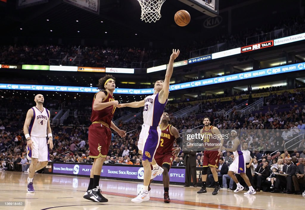 <a gi-track='captionPersonalityLinkClicked' href=/galleries/search?phrase=Steve+Nash+-+Basketball+Player&family=editorial&specificpeople=201513 ng-click='$event.stopPropagation()'>Steve Nash</a> #13 of the Phoenix Suns lays up a shot past <a gi-track='captionPersonalityLinkClicked' href=/galleries/search?phrase=Anderson+Varejao&family=editorial&specificpeople=202247 ng-click='$event.stopPropagation()'>Anderson Varejao</a> #17 of the Cleveland Cavaliers during the NBA game at US Airways Center on January 12, 2012 in Phoenix, Arizona. The Cavaliers defeated the Suns 101-90.