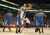 Steve Nash of the Phoenix Suns lays up a shot past Chris Paul of the New Orleans Hornets during the NBA game at US Airways Center on November 11 2009...