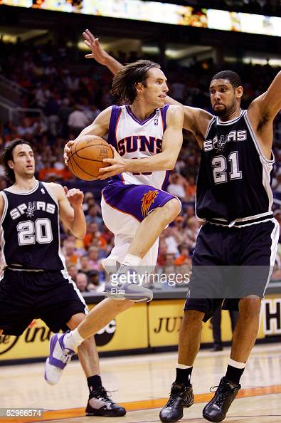 Steve Nash of the Phoenix Suns looks to pass under pressure from Tim Duncan and Manu Ginobili of the San Antonio Spurs in Game one of the Western...