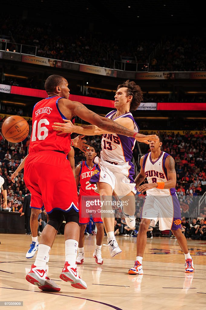 Steve Nash of the Phoenix Suns maks a pass around Marreese Speights of the Philadelphia 76ers in an NBA Game played on February 24 2010 at US Airways...