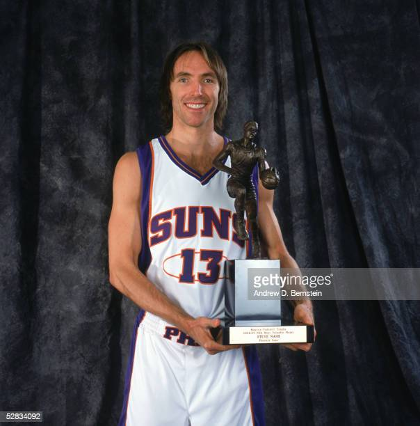Steve Nash of the Phoenix Suns poses with the Maurice Podoloff Trophy for the NBA's Most Valuable Player for the 20042005 season prior to Game one of...