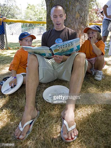 Steve Nash of the Phoenix Suns reads to children to help promote literacy during a visit to his hometown of Victoria July 20 2006 in British Columbia...