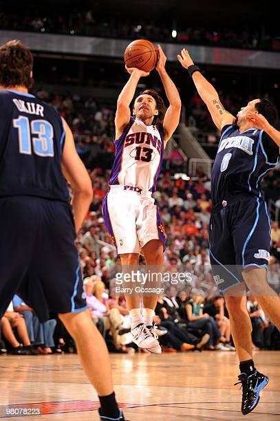 Steve Nash of the Phoenix Suns shoots a jump shot against Mehmet Okur and Deron Williams of the Utah Jazz during the game at US Airways Center on...