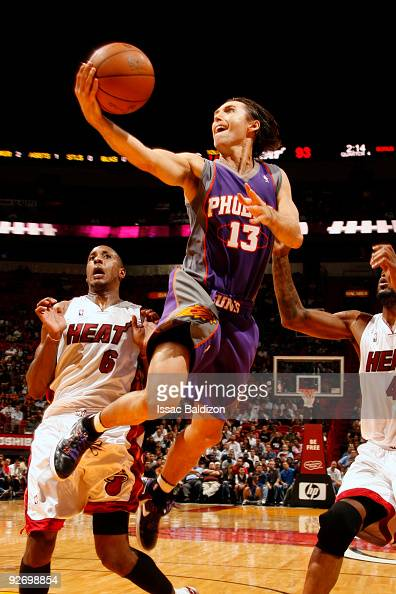 Steve Nash of the Phoenix Suns shoots against Mario Chalmers and Udonis Haslem of the Miami Heat on November 3 2009 at American Airlines Arena in...