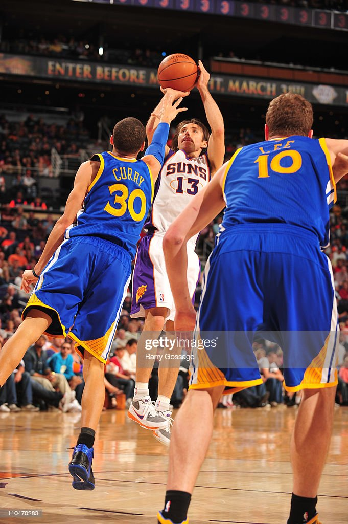 <a gi-track='captionPersonalityLinkClicked' href=/galleries/search?phrase=Steve+Nash&family=editorial&specificpeople=201513 ng-click='$event.stopPropagation()'>Steve Nash</a> #13 of the Phoenix Suns shoots over Stephen Curry #30 of the Golden State Warriors in an NBA game played on March 18, 2011 at U.S. Airways Center in Phoenix, Arizona.
