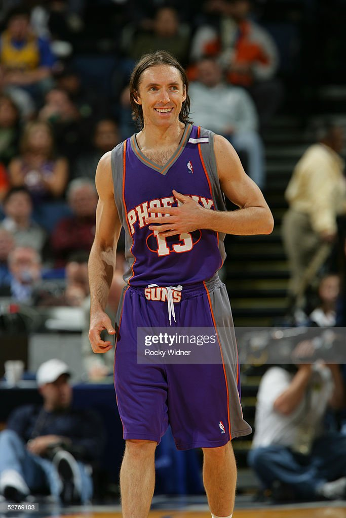 Steve Nash of the Phoenix Suns smiles during the game against the Golden State Warriors at the Arena in Oakland on April 8 2005 in Oakland California...