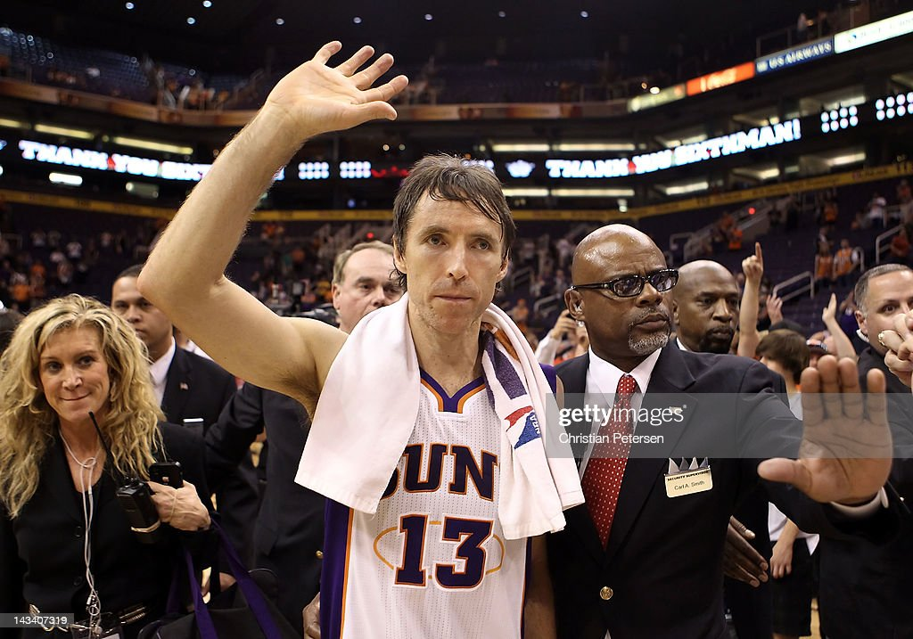<a gi-track='captionPersonalityLinkClicked' href=/galleries/search?phrase=Steve+Nash&family=editorial&specificpeople=201513 ng-click='$event.stopPropagation()'>Steve Nash</a> #13 of the Phoenix Suns waves to fans as he walks off the court following the NBA game against the San Antonio Spurs at US Airways Center on April 25, 2012 in Phoenix, Arizona. The Spurs defeated the Suns 110-106.