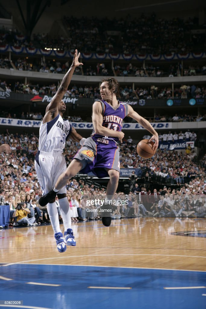 Steve Nash of the Phoenix Suns whips the nifty behind the back pass against the Dallas Mavericks in Game three of the Western Conference Semifinals...