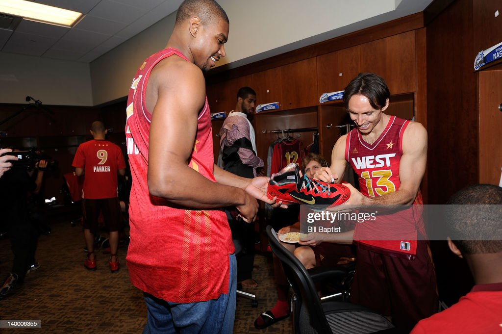 <a gi-track='captionPersonalityLinkClicked' href=/galleries/search?phrase=Steve+Nash+-+Basketball+Player&family=editorial&specificpeople=201513 ng-click='$event.stopPropagation()'>Steve Nash</a> #13 of the Western Conference All-Stars signs an autograph for teammate <a gi-track='captionPersonalityLinkClicked' href=/galleries/search?phrase=Andrew+Bynum&family=editorial&specificpeople=630695 ng-click='$event.stopPropagation()'>Andrew Bynum</a> #17 during the 2012 NBA All-Star Game presented by Kia Motors as part of 2012 All-Star Weekend at the Amway Center on February 26, 2012 in Orlando, Florida.