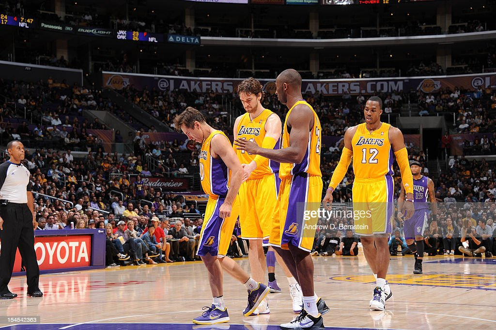 <a gi-track='captionPersonalityLinkClicked' href=/galleries/search?phrase=Steve+Nash&family=editorial&specificpeople=201513 ng-click='$event.stopPropagation()'>Steve Nash</a> #10, <a gi-track='captionPersonalityLinkClicked' href=/galleries/search?phrase=Pau+Gasol&family=editorial&specificpeople=201587 ng-click='$event.stopPropagation()'>Pau Gasol</a> #16, <a gi-track='captionPersonalityLinkClicked' href=/galleries/search?phrase=Kobe+Bryant&family=editorial&specificpeople=201466 ng-click='$event.stopPropagation()'>Kobe Bryant</a> #24, and <a gi-track='captionPersonalityLinkClicked' href=/galleries/search?phrase=Dwight+Howard&family=editorial&specificpeople=201570 ng-click='$event.stopPropagation()'>Dwight Howard</a> #12 of the Los Angeles Lakers walk toward the bench against the Sacramento Kings during a pre-season game at Staples Center on October 21, 2012 in Los Angeles, California.