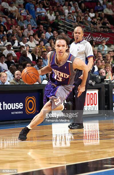 Steve Nash#13 of the Phoenix Suns drive down the baseline against the Orlando Magic March 26 2005 at TD Waterhouse Centre in Orlando Florida The Suns...
